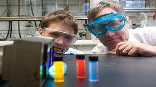 two people in chemistry lab looking at samples